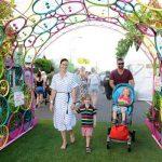 family walking through arch