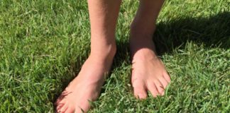 feet on green grass