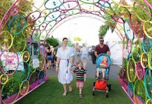 bike arch with happy family walking through