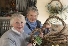 two women making wreaths