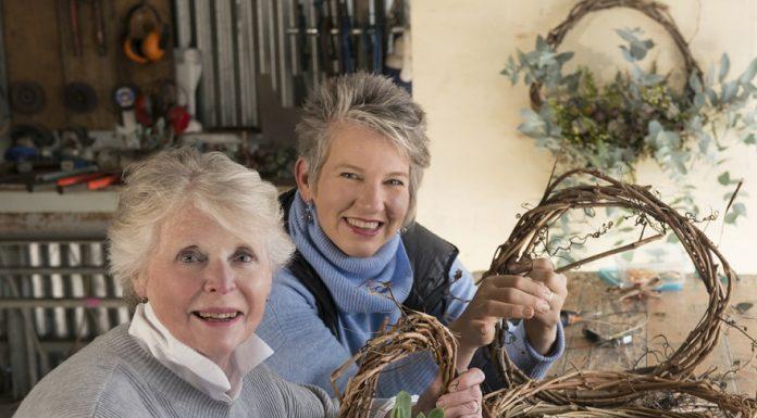two women making wreaths