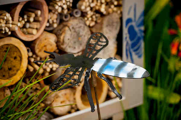 blue bee with insect hotel