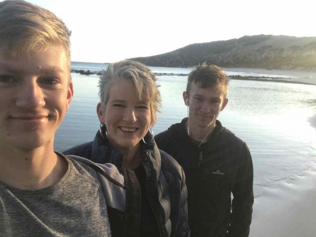 three people on ferry