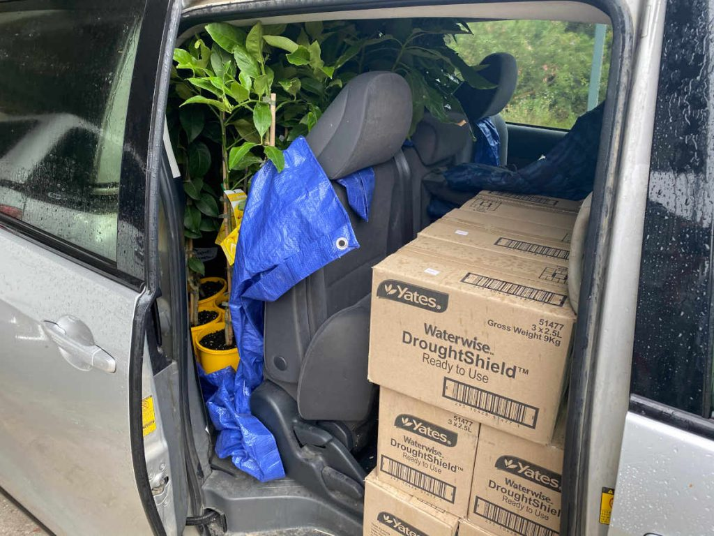 car loaded with gardening things